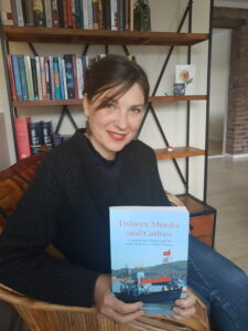 Edyta Roszko holding a copy of her book