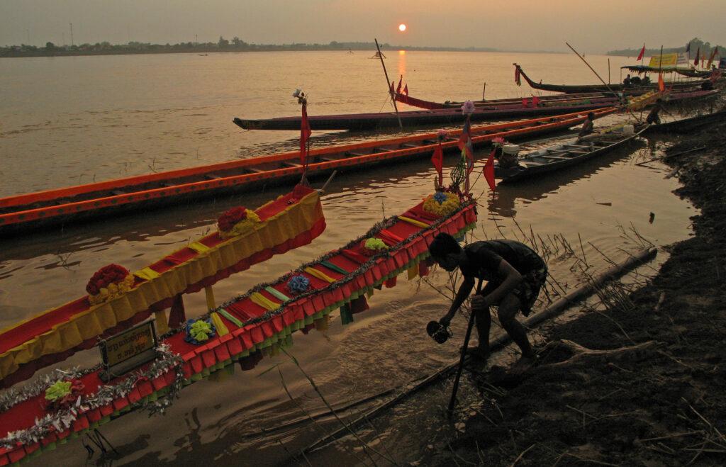 Racing boats at dusk on the Mekong